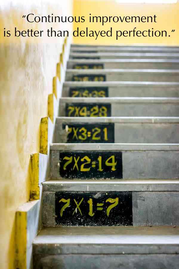 Photo of stairs advancing upward with multiplication equation of 7 times 1 and ascending with each step to the next number in the seven series.